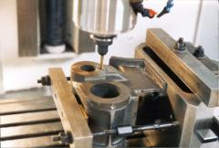 Summer 2003 - Bill W., runs a bolt-circle program in a CNC mill to drill and tap the cover mounting holes.